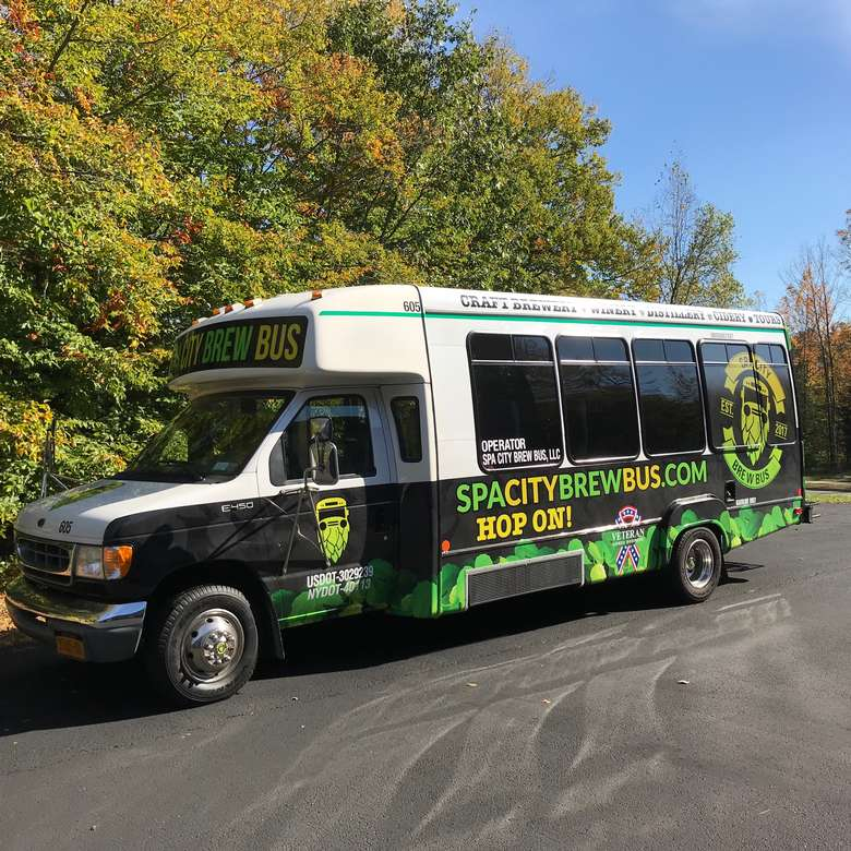 a side view of the spa city brew bus