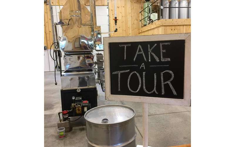 a chalkboard sign that says take a tour