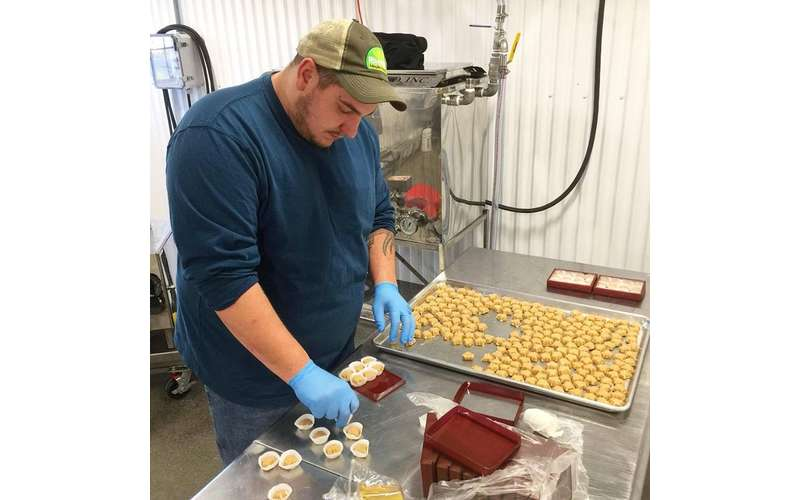 a man making maple candy