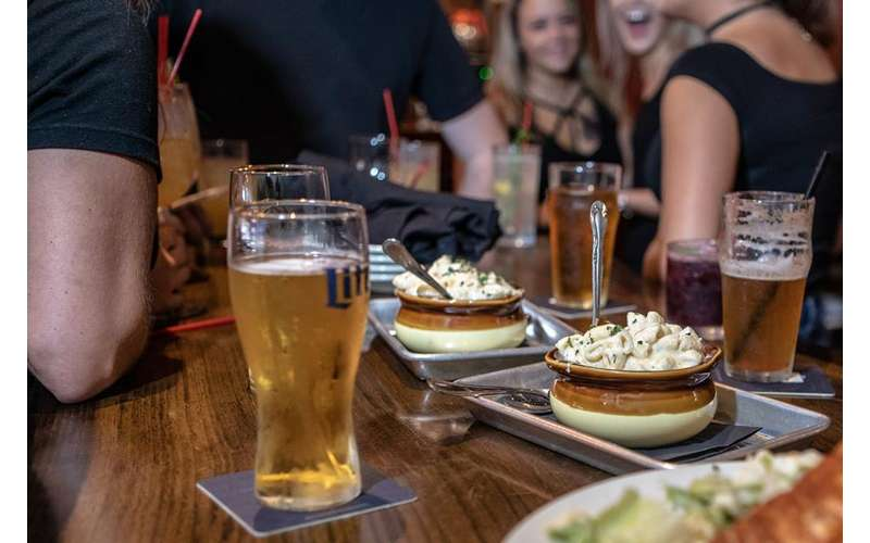 beer and bowls of food on table