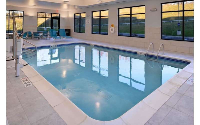 an indoor pool with blue coloring