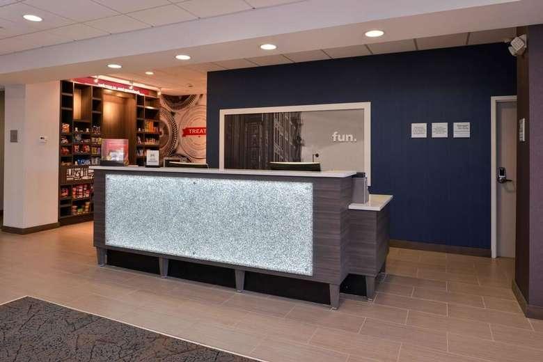 a desk inside a hotel lobby