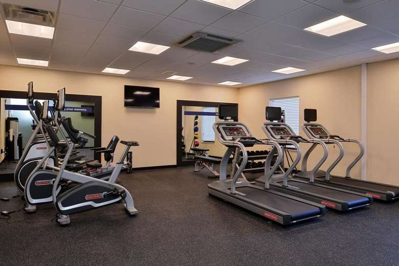 exercise machines inside a fitness center