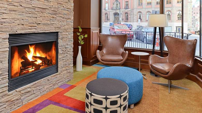 fireplace and chairs in Fairfield Inn and Suites lobby