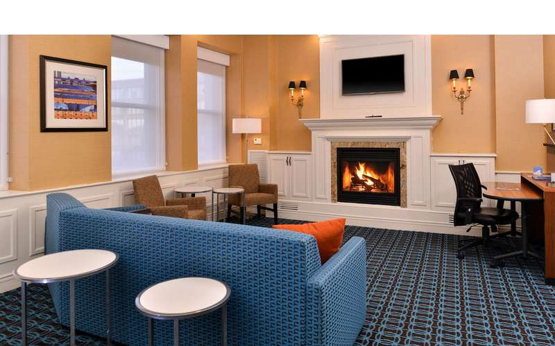 Fairfield Inn and Suites bedroom with couch and fireplace