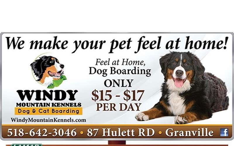 a promo and price poster for windy mountain kennels