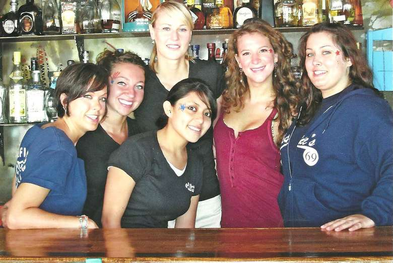 group photo of smiling staff members at SJ Garcia's