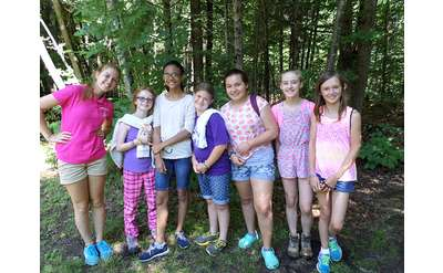 group of girls posing in the woods