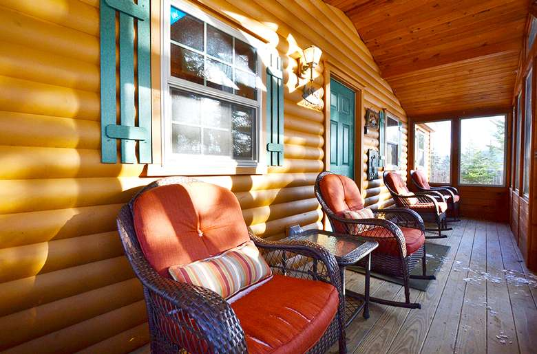 four rocking chairs on screened-in porch