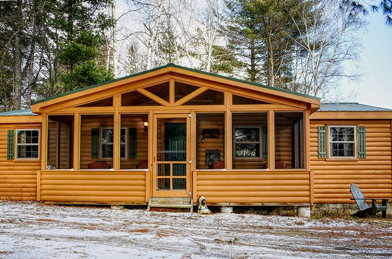 the front of a cabin vacation rental