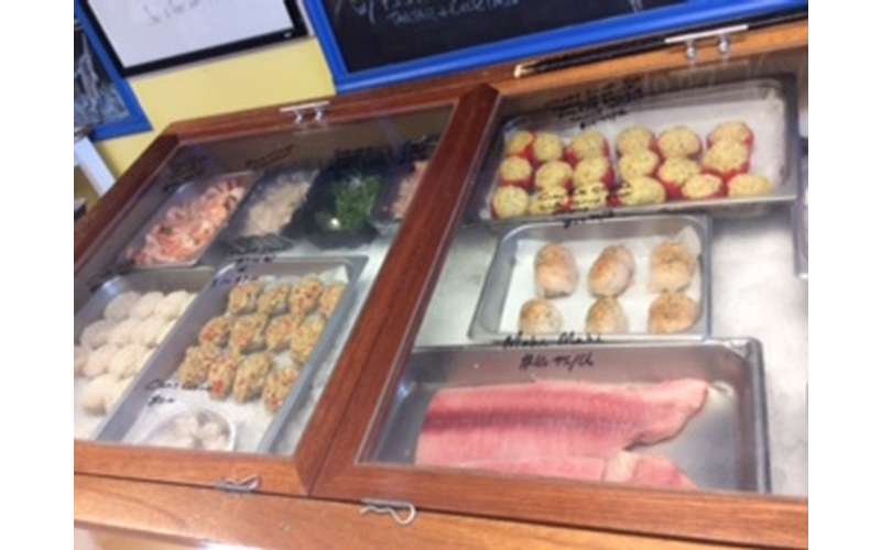 two market display cases filled with fresh fish