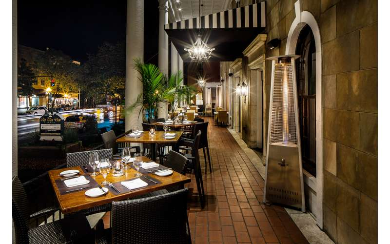 an outdoor patio dining area in the evening