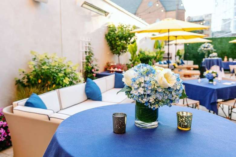 a patio dining area with blue and yellow decor