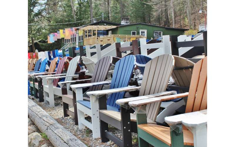 row of different colored Adirondack chairs