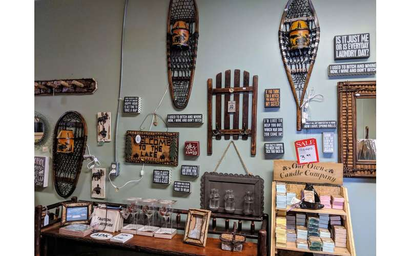 signs and snowshoes hanging on a wall