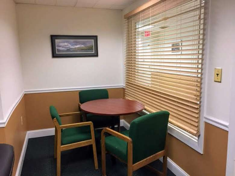 office room with chair and tables