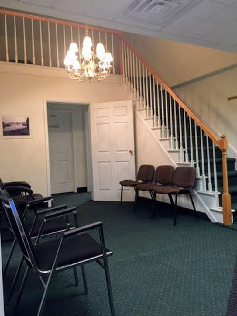 lobby area of office building, stairs, chandelier