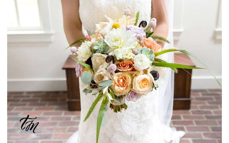 close up photo of bride holding flowers