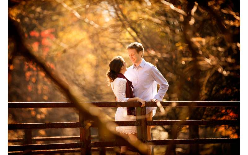 engagement shoot of man and woman on a bridge