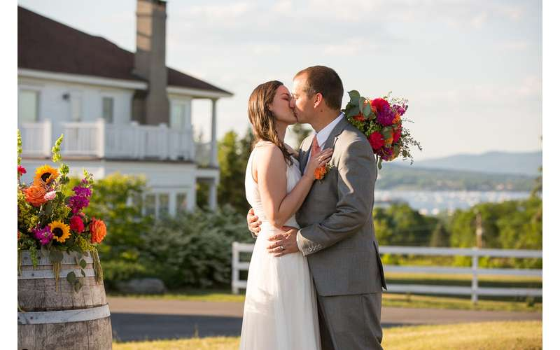 bridge and groom kissing at outdoor wedding