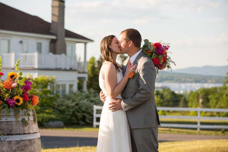 bridge and groom kissing at outdoor wedding