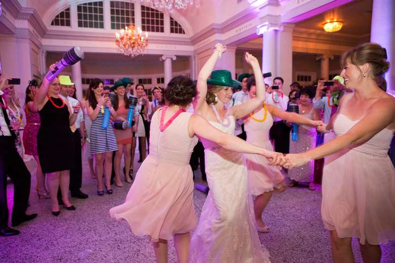 group of people dancing at indoor wedding party