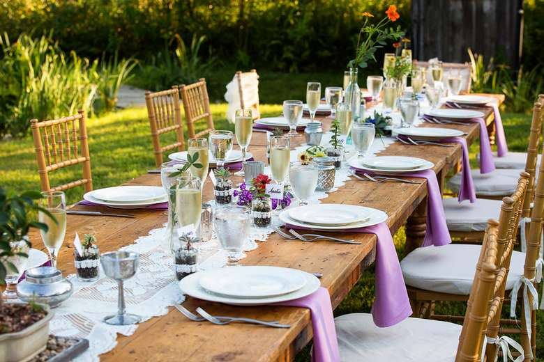 a table decorated and ready for a wedding reception