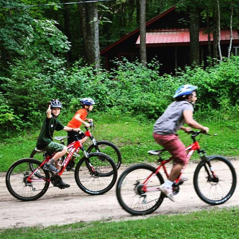 three kids mountain biking