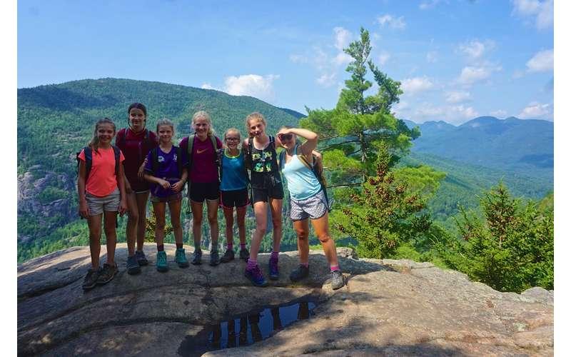 kids on a mountain summit