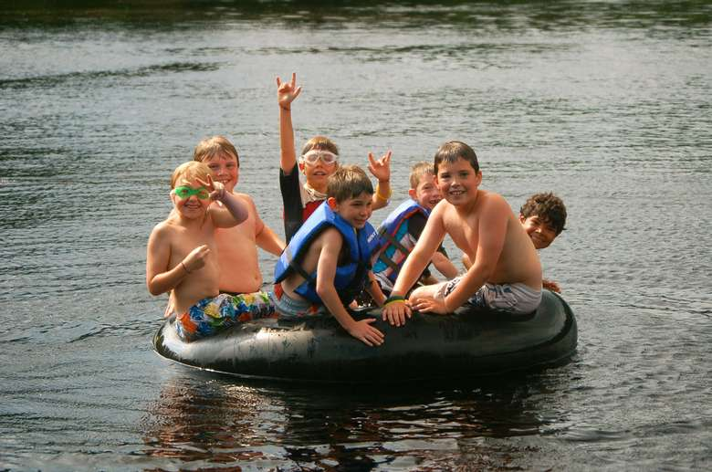 kids in a tube in the water