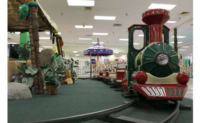 front view of a train inside a kids fun center