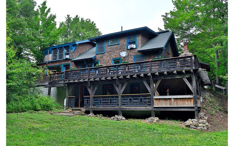 exterior of a large house with two decks