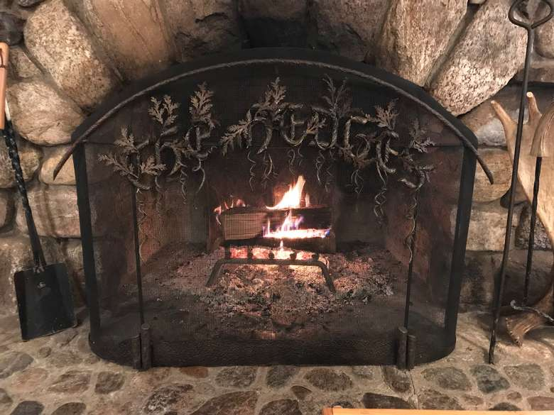 a fireplace with metal grate in front