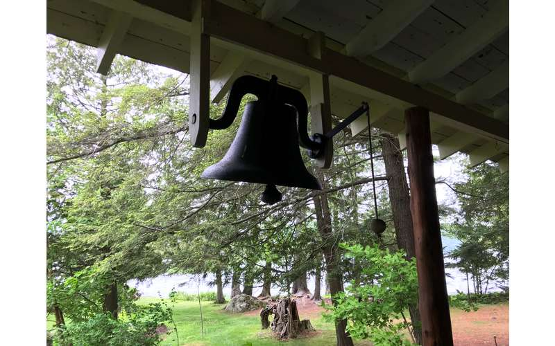 dinner bell hanging from the porch