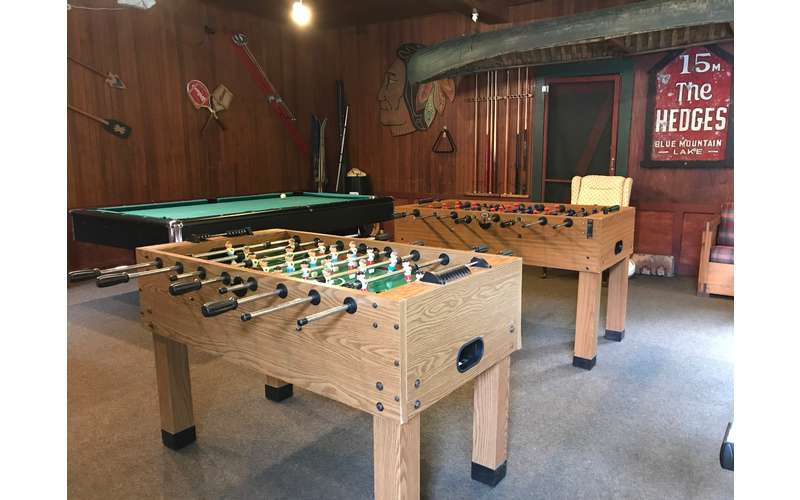foosball and other game tables in a room