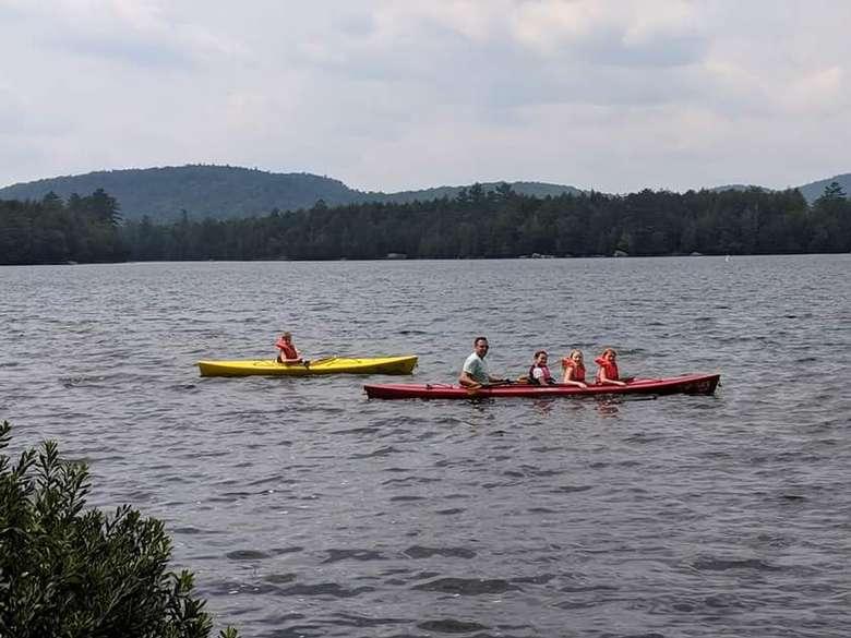 two kayaks on a lake