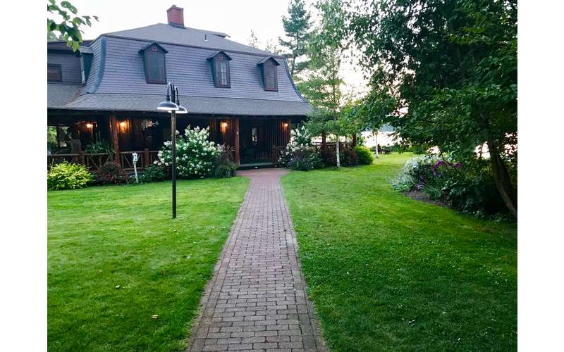 a stone pathway connects Dining Lodge and original lodge