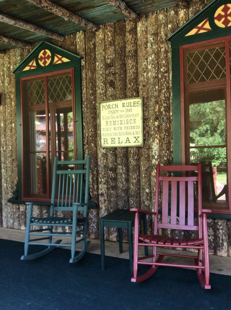 two rocking chairs on a lodge porch