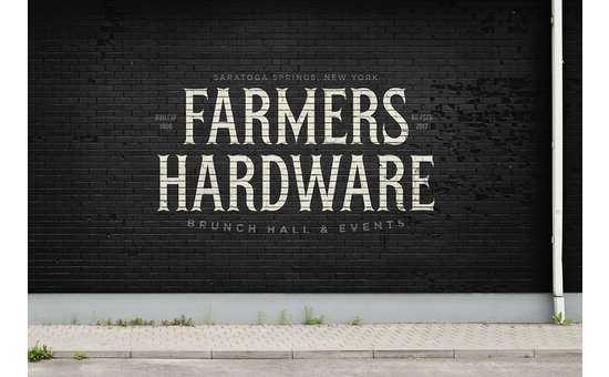 the farmers hardware logo on a black wall