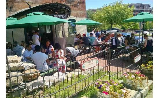 people sitting in an outdoor restaurant patio