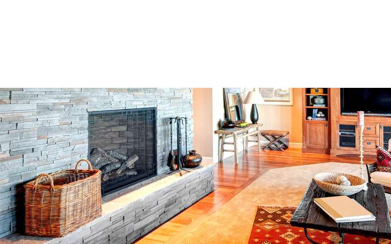living room with a stone fireplace