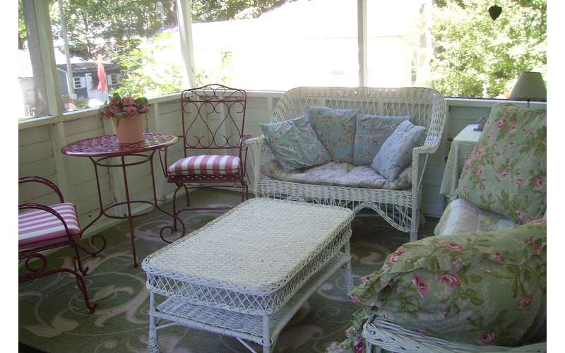 wicker furniture on screened-in porch