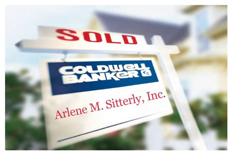 sold sign with a coldwell banker sign