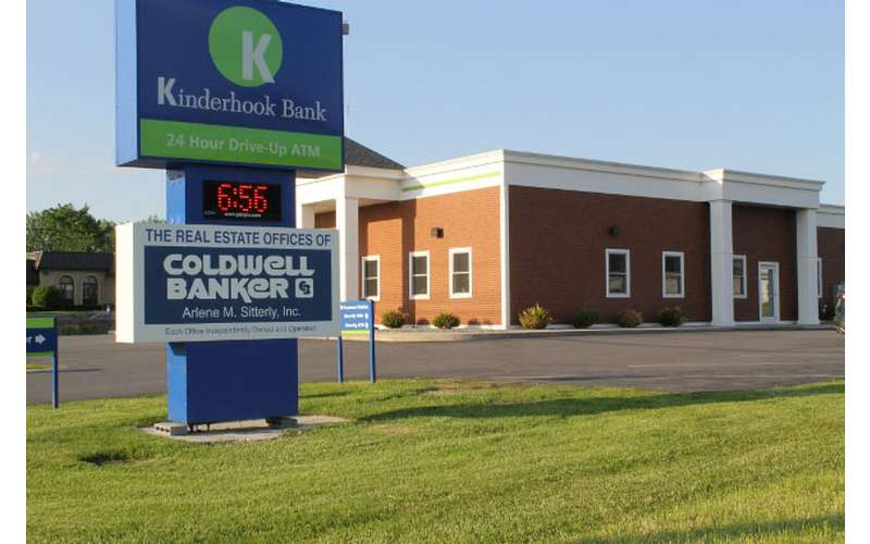 large outdoor sign that says coldwell banker and kinderhook bank