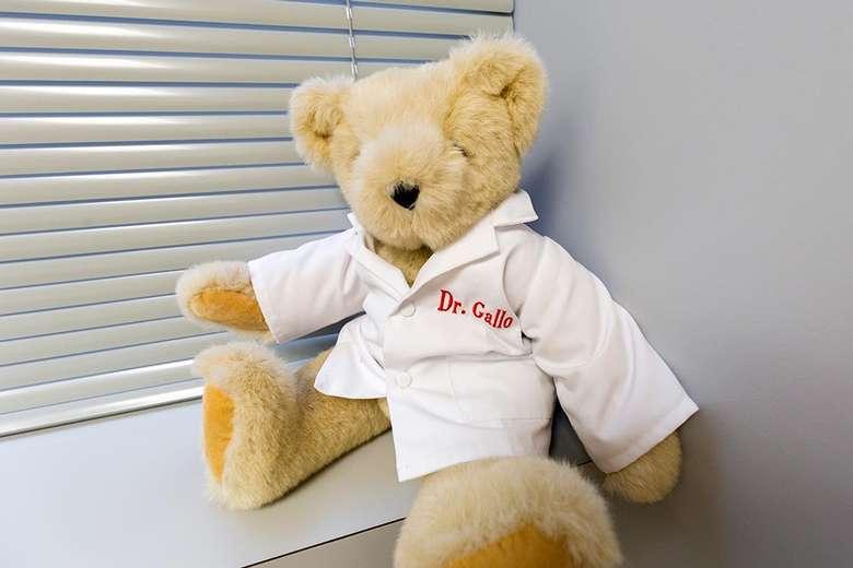 teddy bear with a dr. gallo shirt