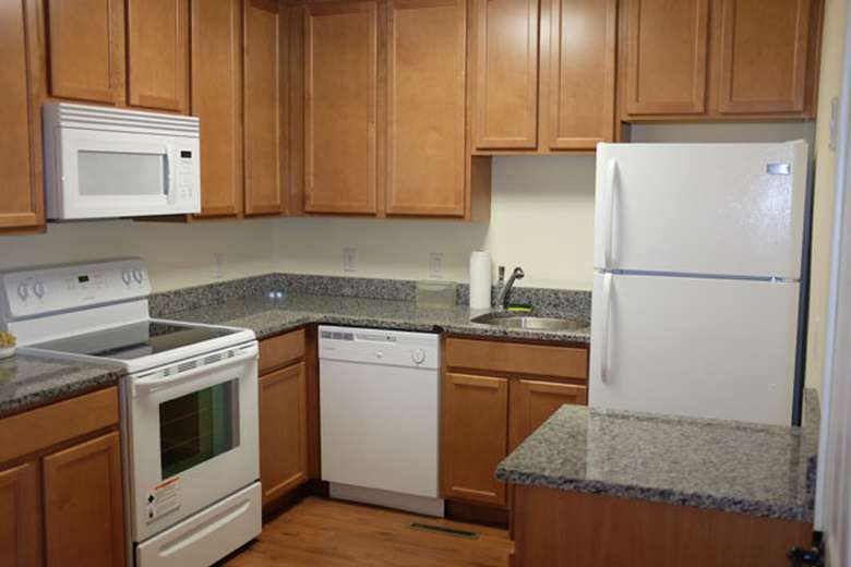 kitchen with microwave, fridge, and oven