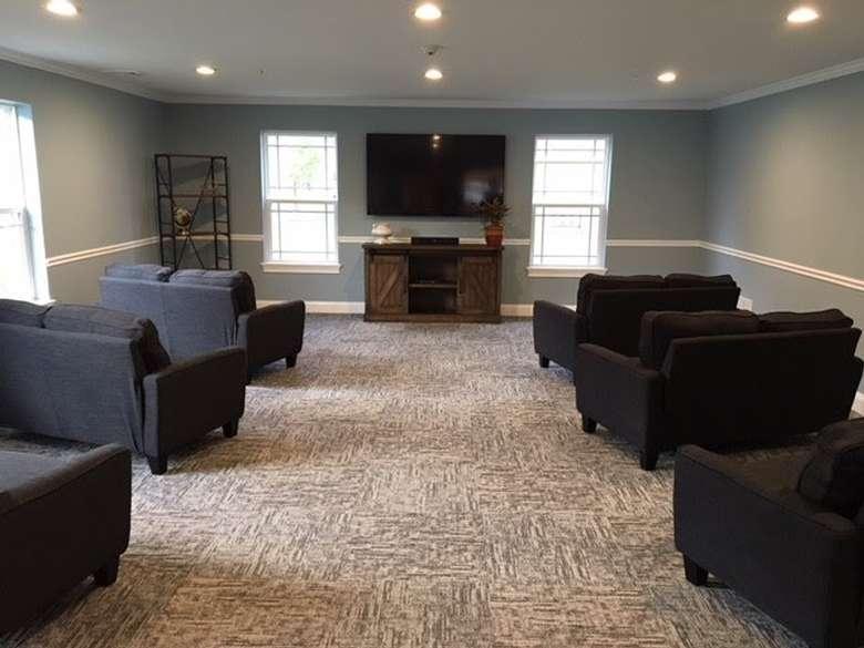 black sofas facing a tv