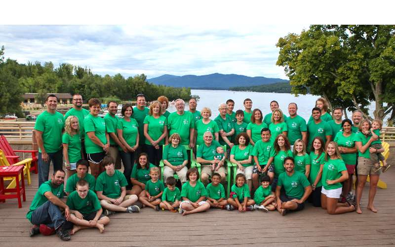 large group of people wearing green shirts