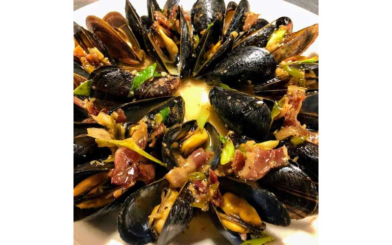 a seafood dish with muscles