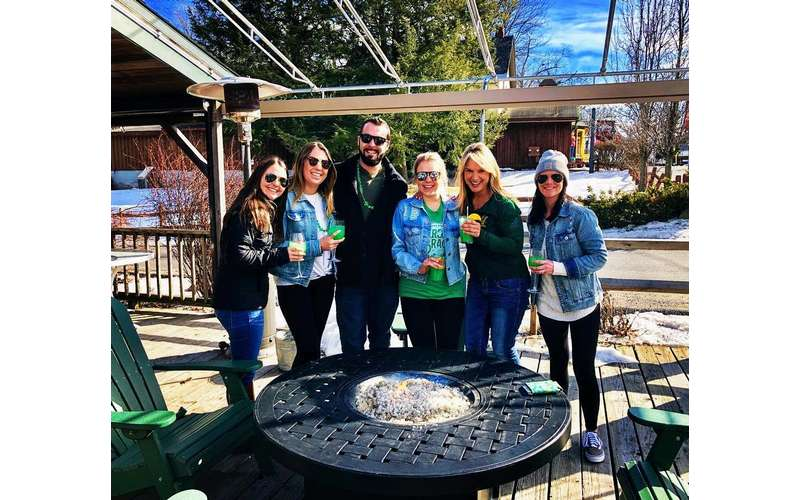 people in St. Patrick's Day gear on a deck